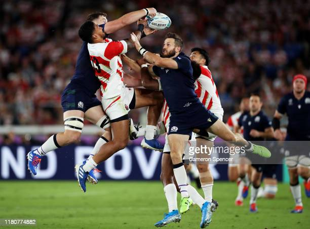 Timothy Lafaele of Japan jumps for a high ball with Tommy Seymour and Magnus Bradbury of Scotland during the Rugby World Cup 2019 Group A game...