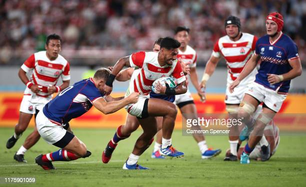 Timothy Lafaele of Japan runs with the ball during the Rugby World Cup 2019 Group A game between Japan and Russia at the Tokyo Stadium on September...