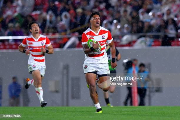 Timothy Lafaele of Japan runs with the ball to score his side's second try during the rugby friendly between Japan and World XV at Hanazono Rugby...