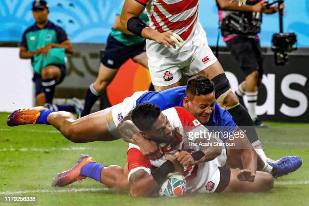 Timothy Lafaele of Japan scores his side's first try during the Rugby World Cup 2019 Group A game between Japan and Samoa at City of Toyota Stadium...