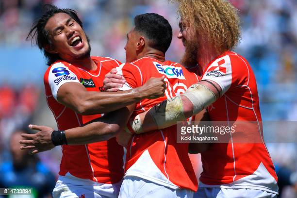 Timothy Lafaele of Sunwolves celebrates celebrates scoring his try with his teammates during the Super Rugby match between the Sunwolves and the...