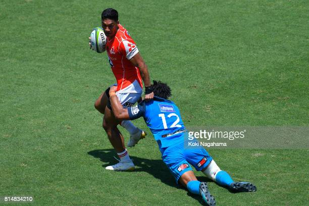 Timothy Lafaele of Sunwolves hands off against Tinoai Faiane of Blues during the Super Rugby match between the Sunwolves and the Blues at Prince...