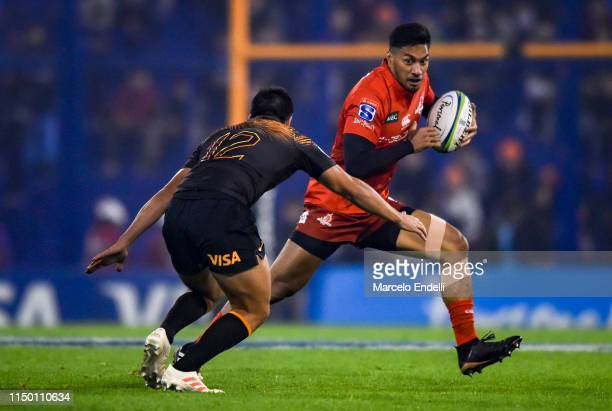 Timothy Lafaele of Sunwolves hands off Santiago Gonzalez Iglesias of Jaguares during a match between Jaguares and Sunwolves as part of Round 18th of...