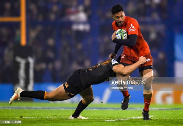 Timothy Lafaele of Sunwolves is tackled by Santiago Gonzalez Iglesias of Jaguares during a match between Jaguares and Sunwolves as part of Round 18th...