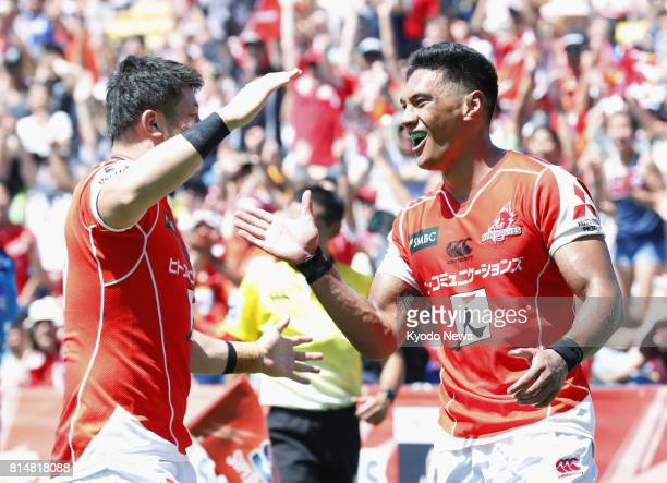 Timothy Lafaele of the Sunwolves celebrates with his teammate after scoring a try during the second half of a Super Rugby game against the Blues at...