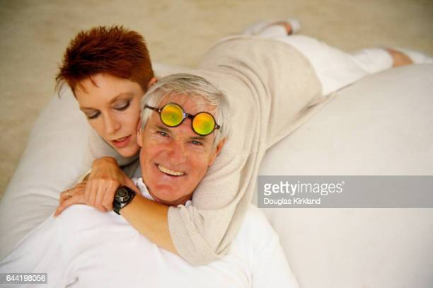 Timothy Leary lies on a bed with his wife actress Barbara Chase
