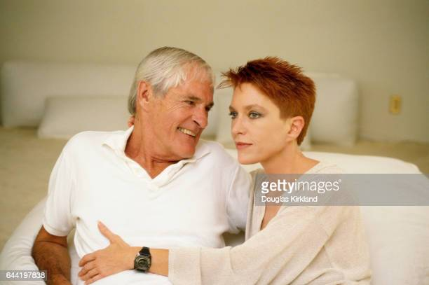 Timothy Leary sits on a bed with his wife Barbara Chase