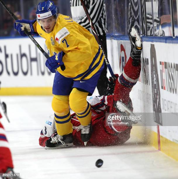 Timothy Liljegren of Sweden checks Martin Necas of Czech Republic in the second period during the IIHF World Junior Championship at KeyBank Center on...