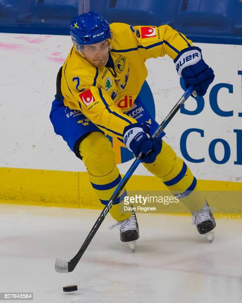 Timothy Liljegren of Sweden passes the puck against USA during a World Jr Summer Showcase game at USA Hockey Arena on August 2 2017 in Plymouth...