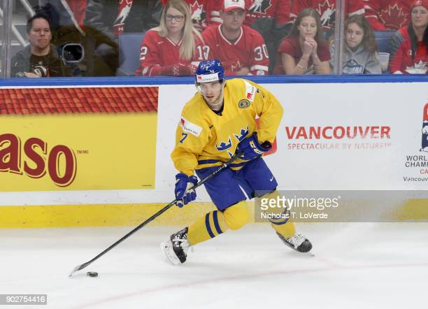 Timothy Liljegren of Sweden skates the puck against Canada during the second period of play in the IIHF World Junior Championships Gold Medal game at...
