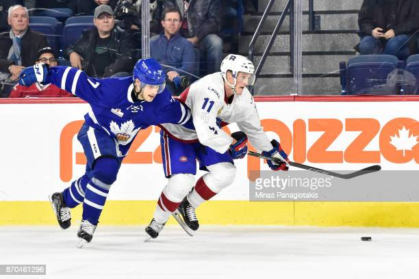 Timothy Liljegren of the Toronto Marlies challenges Daniel Carr of the Laval Rocket during the AHL game at Place Bell on November 1 2017 in Laval...