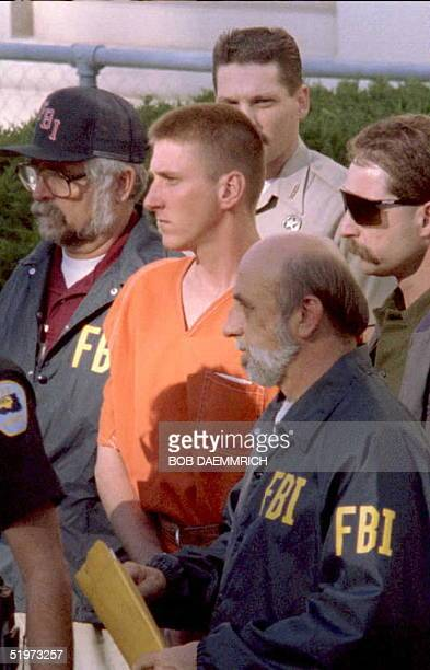 Timothy McVeigh is led from the Noble County Courthouse in Perry Oklahoma by FBI agents after being charged 21 April with involvement in the bombing...