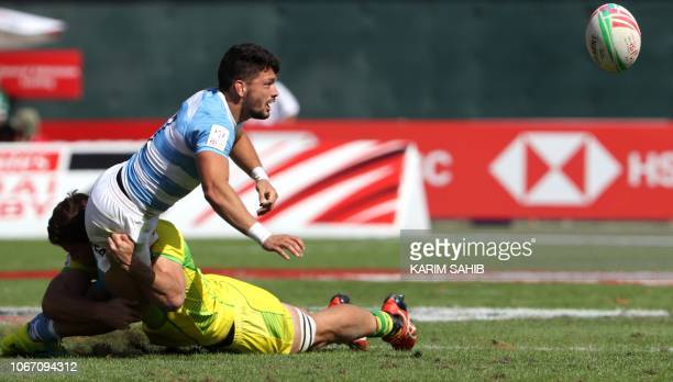Timothy Mitcgell Anstee of Australia tackles Lautaro Bazan Velez of Argentina during the Men's Sevens World Rugby Dubai Series Cup Quarter Final...