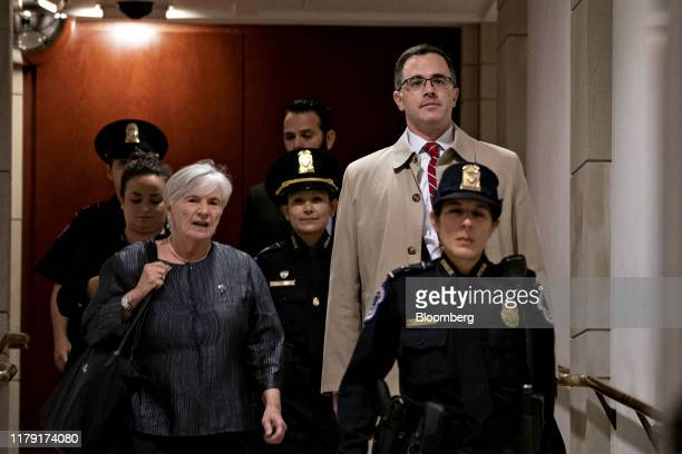 Timothy Morrison former National Security Council aide right arrives to testify for a closeddoor deposition before House committees on Capitol Hill...