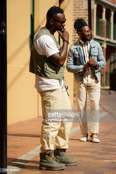 Timothy Omaji aka Timomatic wearing Timberland boots, Helly Hansen pants, Thrills t-shirt and Sports Afield vest and Marvin Osifo wearing Zara black...