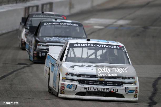 Timothy Peters driver of the Friends of Jaclyn Foundation Chevrolet leads a pack of cars during the NASCAR Gander Outdoors Truck Series Ultimate...