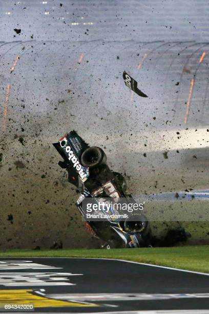 Timothy Peters driver of the Metabo Chevrolet flips through the infield after crashing during the NASCAR Camping World Truck Series...