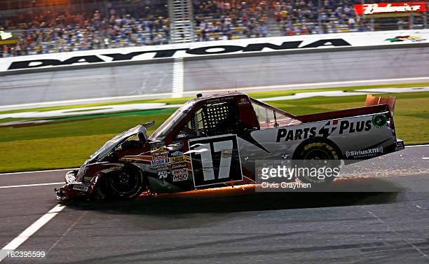 Timothy Peters driver of the Parts Plus Toyota pits after an incident during the NASCAR Camping World Truck Series NextEra Energy Resources 250 at...