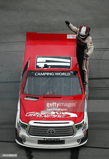 Timothy Peters driver of the Red Horse Racing Toyota celebrates after winning the NASCAR Camping World Truck Series fred's 250 at Talladega...