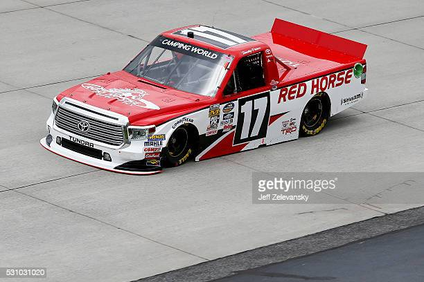 Timothy Peters driver of the Red Horse Racing Toyota practices for the NASCAR Camping World Truck Series at Dover International Speedway on May 12...