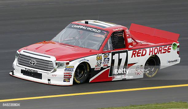 Timothy Peters driver of the Red Horse Racing Toyota practices for the NASCAR Camping World Truck Series Buckle Up In Your Truck 225 at Kentucky...