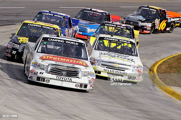 Timothy Peters driver of the Strutmaster/Red Horse Racing Toyota leads a group of trucks during the NASCAR Camping World Truck Series Kroger 200 at...