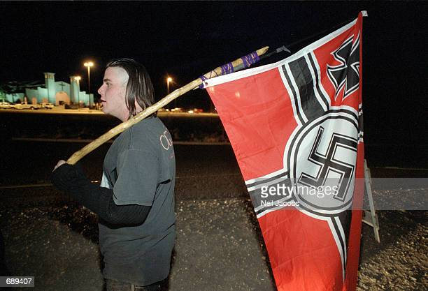 Timothy Richards compares bookburning to Nazism as he protests the burning of Harry Potter books outside the Christ Community Church December 30 2001...