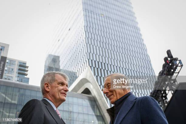 Timothy Sloan chief executive officer of Wells Fargo speaks with Stephen Ross chairman and majority owner of the Related Companies talk with each...