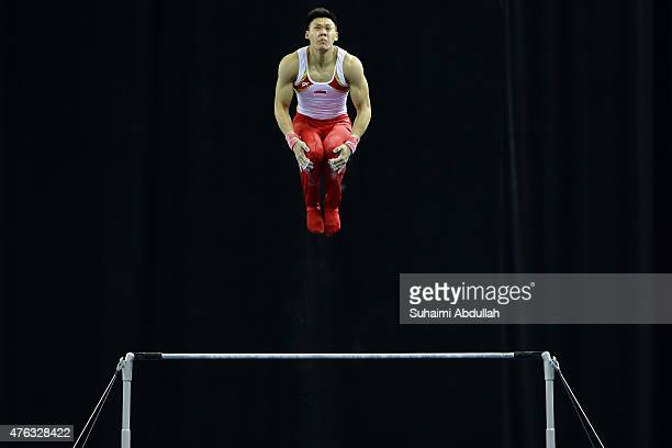 Timothy Tay of Singapore in action during the horizontal bar event in the men's gymnastic individual allaround final at the Bishan Sports Hall during...