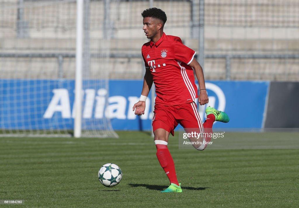 Timothy Tillman of FC Bayern Muenchen kicks the ball ...
