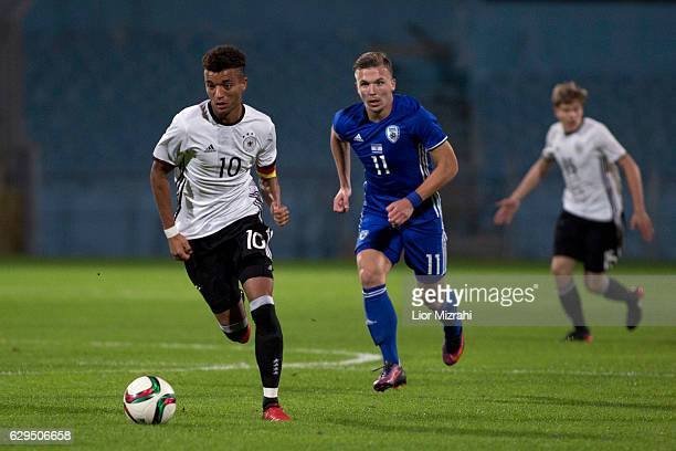 Timothy Tillman of Germany challenges Eden Karzev of Israel during the Under 18 International Friendly match between Israel and Germany on December...