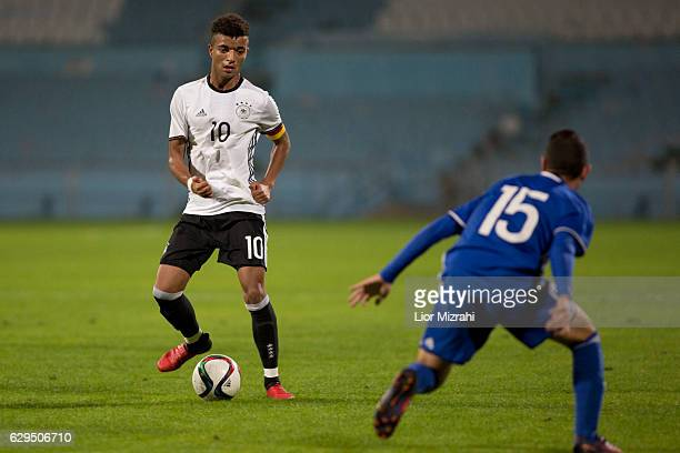 Timothy Tillman of Germany challenges Ron Zamir of Israel during the Under 18 International Friendly match between Israel and Germany on December 13...