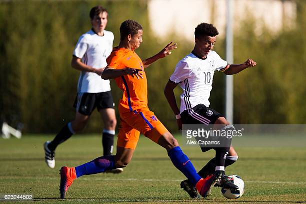 Timothy Tillman of Germany protects the ball from Justin Lonwijk of Netherlands during the U18 international friendly match between Netherlands and...