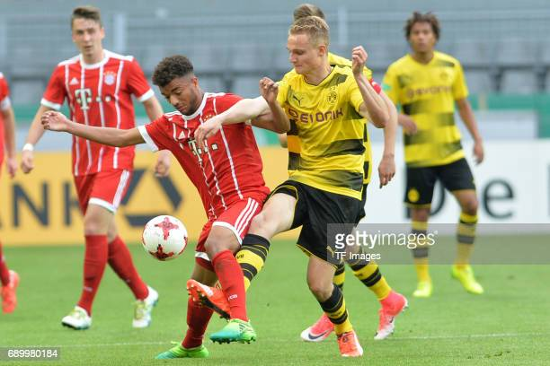 Timothy Tillman of Munich and Amos Pieper of Dortmund battle for the ball during the U19 German Championship Final match between U19 Borussia...
