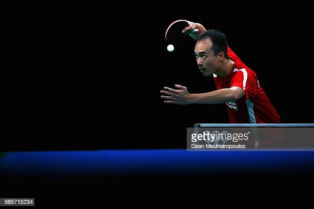 Timothy Wang of Team USA looks at the ball as he gets ready to serve at the Table Tennis practice session during the Olympics preview day 2 at Rio...
