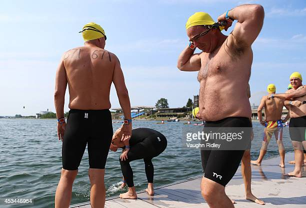 Timothy Waud of the US competes in the Men's 4549 Age Group 3km swim during the 15th FINA World Masters Championships at Parc JeanDrapeau on August...