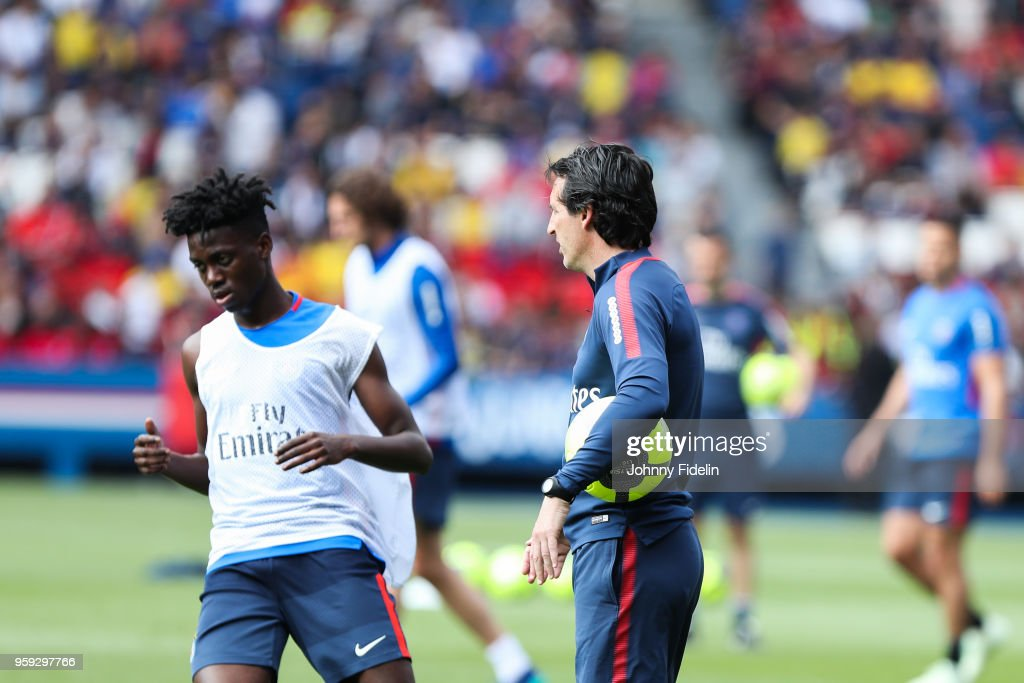 Timothy Weah and Unai Emery head coach of PSG during the training session of Paris Saint Germain at Parc des Princes on May 16, 2018 in Paris, France.
