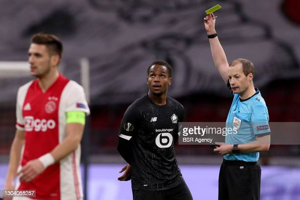 Timothy Weah of Lille OSC, Referee William Collum during the UEFA Europa League match between Ajax and Lille OSC at Johan Cruijf Arena on February...