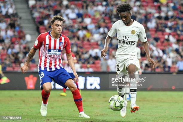 Timothy Weah of Paris Saint Germain and Carlos Isaac of Atletico Madrid competes for the ball during the International Champions Cup match between...