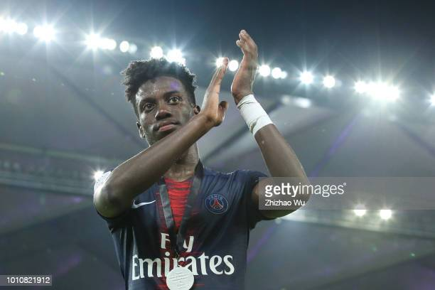 Timothy Weah of Paris Saint Germain celebrates the champion after the match between Paris Saint Germain and Monaco at Shenzhen Longgang Sports Center...
