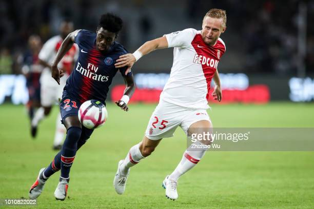 Timothy Weah of Paris SaintGermain and Kamil Glik of Monaco in action during the match between Paris Saint Germain and Monaco at Shenzhen Longgang...