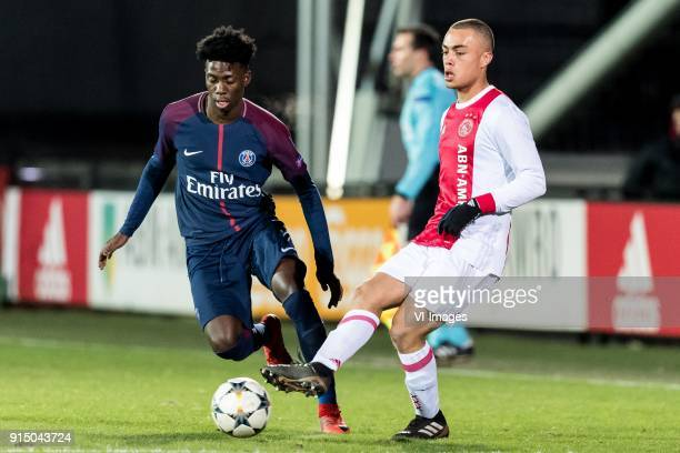 Timothy Weah of Paris SaintGermain U19 Sergino Dest of Ajax U19 during the UEFA Youth League play off match between Ajax U19 and Paris Saint Germain...