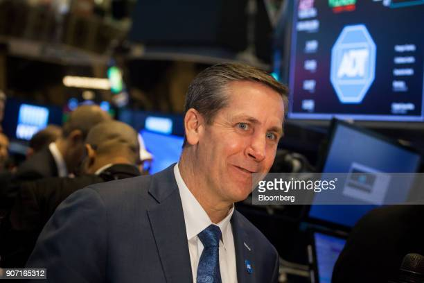 Timothy Whall chief executive officer of ADT Inc stands during the company's initial public offering on the floor of the New York Stock Exchange in...