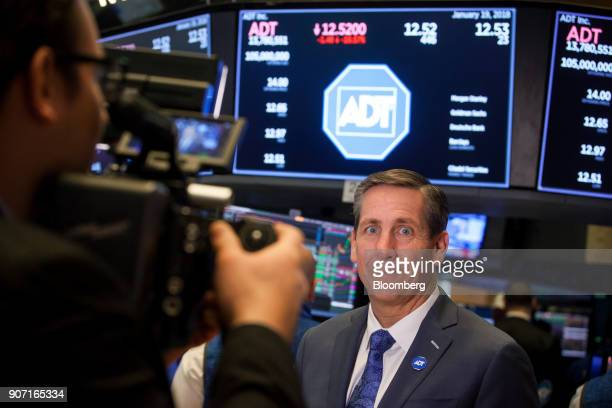 Timothy Whall chief executive officer of ADT Inc stands for a photograph during the company's initial public offering on the floor of the New York...