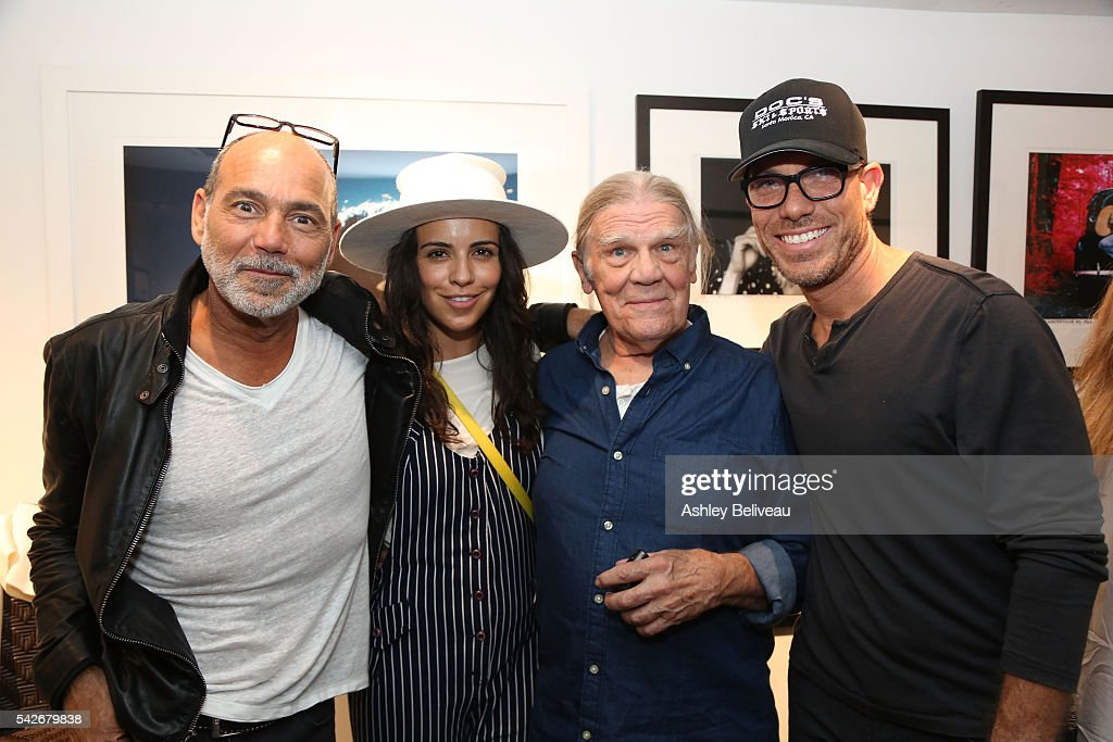 Timothy White, Olga Segura, Henry Diltz, and Loren Schwartz attend the celebration for 'Don't Look Back' exhibit at Morrison Hotel Gallery on June 23, 2016 in West Hollywood, California.