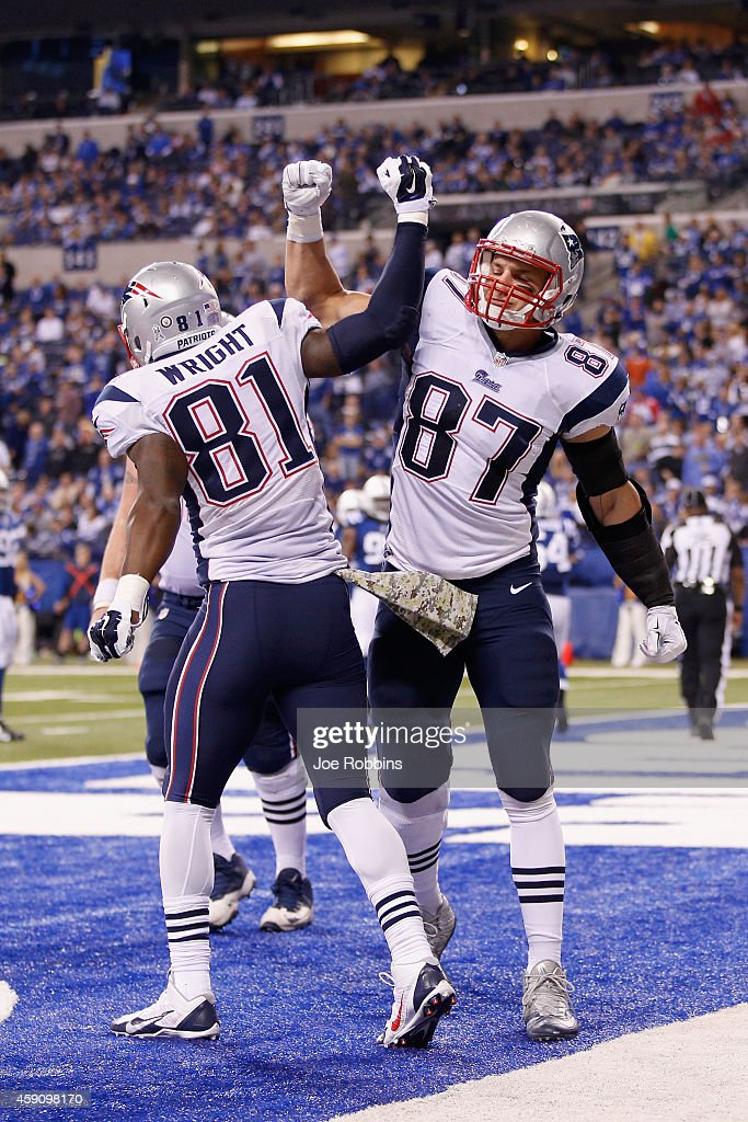 Timothy Wright #81 of the New England Patriots is congratulated on his touchdown by teammate Rob Gronkowski #87 during the third quarter of the game at Lucas Oil Stadium on November 16, 2014 in Indianapolis, Indiana.