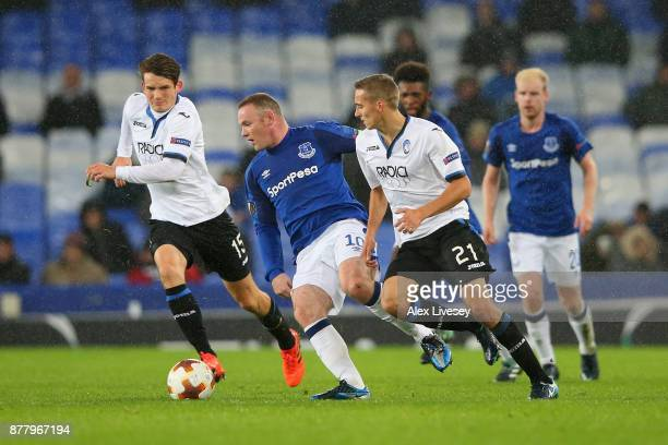 Timoty Castagne of Atalanta and Wayne Rooney of Everton battle for possession during the UEFA Europa League group E match between Everton FC and...