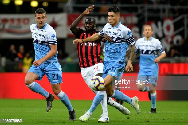 TiŽmou Bakayoko of AC Milan compete for the ball with Joaquin Correa of SS Lazio during the TIM Cup match between AC Milan and SS Lazio at Stadio...