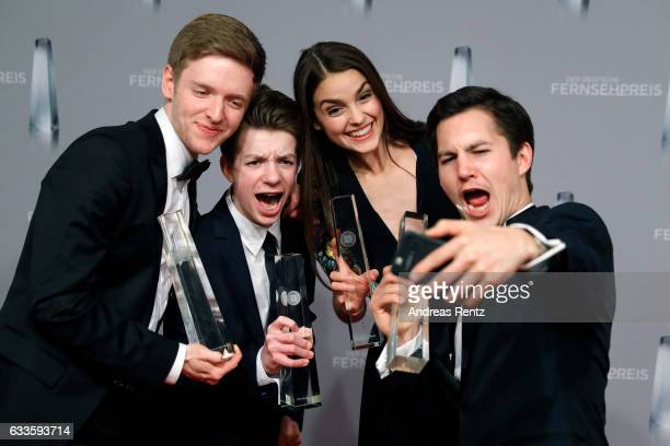 Timur Bartels Nick Julius Schuck Luise Befort and Ivo Kortland of 'Club der Roten Baender' take a selfie with their awards at the German Television...