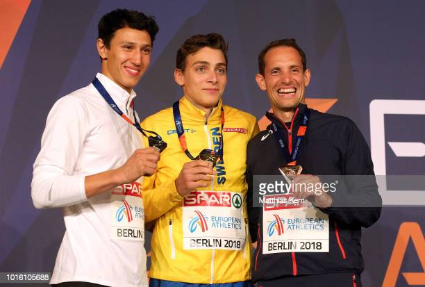 Timur Morgunov of Authorised Neutral Athletes silver Armand Duplantis of Sweden gold and Renaud Lavillenie of France bronze pose with their medals...
